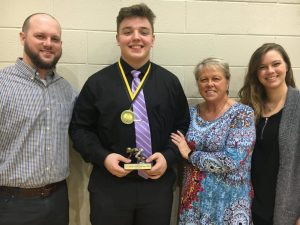 In addition to his MVP trophy, Isaac Cross received the Coach Clay Edwards Memorial Tiger Pride Award for the second year. The Clay Edwards Award was presented to Cross by members of Edwards' family, Abram Edwards (left) and Sarah Rathbone (far right), son and daughter, and their mother Tena Edwards-Jacobs.