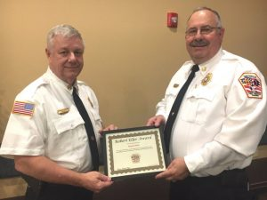 """Smithville Volunteer Firefighter and Deputy Chief Hoyte Hale (right) received the """"Robert Eller Highest Attendance Award"""" in January during an appreciation dinner for city firefighters at the New Life Connection Center. The award was presented to Hale by Smithville Fire Chief Charlie Parker. This is the sixth straight year Hale has earned this award named in honor of the late Robert Eller, who served the Smithville Fire Department as a member and assistant chief for 64 years until his death in 2009. Out of the 140 incident calls, 56 training responses, and 10 workings during 2019, Hale, a 35 year veteran of the department, attended a total of 173"""