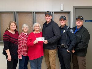 """Almost $700 was raised by the Smithville Police Department through the """"No Shave November"""" campaign. No-Shave November is a nationwide fundraiser for cancer awareness. This year's observance was in memory of the late Margaret Judkins, mother of Smithville Police Officer Will Judkins and all proceeds went to the American Cancer Society. Chief Mark Collins presented the check for $680 Friday to Iva Dell Randolph. Pictured left to right: Marlene Delong, Community Representative for the American Cancer Society, Gail Taylor, Iva Dell Randolph, Chief Mark Collins, Officer Will Judkins, and Captain Steven Leffew"""