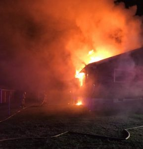 A home on Estes Street in Smithville was heavily damaged by fire Friday night. Smithville Fire Chief Charlie Parker said Brad Driver lived there but he was not home at the time of the fire. (Tim Holmes Photo)