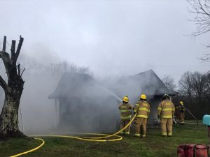 A couple jumped out the window of their home early Thursday morning after waking to find it on fire. Craig Asberry and his wife escaped unharmed but their home at 158 Prater Road, which belonged to Delane Taylor, was gutted in the blaze.