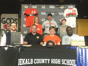 Bill Miller, a senior at DCHS and a star Tiger Soccer player signed a letter of intent with Milligan College near Johnson City, Tennessee on Monday to play collegiate soccer for the Buffaloes next season after he graduates in May. Joining Miller for the signing were members of his family, coaches, and fellow players. Pictured seated left to right are DMS Soccer Coach Justin Nokes, DCHS Soccer Coach Dylan Kleparek, Bill Miller, and Miller's Club Soccer Coach Tre Arhatba. Standing left to right are Miller's family including mother Kate, father Billy, and brother Cameron Miller