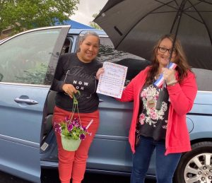 LBJ & C Smithville Head Start Director Cathy Shehane (right) presents parent Silvia Ortiz with the Top Volunteer Award during Wednesday's Drive Through Head Start Graduation