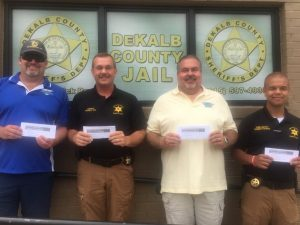 As a way of showing support and appreciation to the department, John Flanders (far left), President of Botanical Incorporated of McMinnville, and Tony Bess (second from right), owner of Smithville Marine, presented Sheriff Patrick Ray and Chief Deputy Robert Patrick (far right) certificates for each sheriff's department employee at Fireman One Barbeque in Smithville.