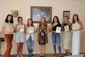 DCHS Basketball Cheerleader Award Winners (left to right) Megan Price, Kortnee Skeen, Makayla Cook, Grace King, Holly Evans, Evie Day, Katie Patterson