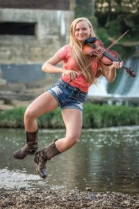 A young dancing fiddler Hillary Klug from Shelbyville who served as an inspiration for a portion of a new mural at the law office of Gayla Hendrix downtown will be making an appearance at the official unveiling Sunday, September 20 at 2 p.m.