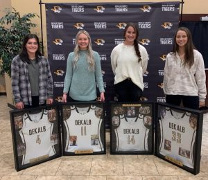 Members of the 2019-20 DeKalb County High School Lady Tigers Basketball Team , who were unable to have their awards banquet in the spring due to COVID-19, were recently recognized for their athletic accomplishments last season. Pictured left to right last year's seniors Mya Ruch, Emme Colwell, Kenzie France, and Megan Walker