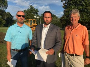 Mike Boyce, co-owner of Boyce Ballard Construction Company of Murfreesboro, the contractor for the Smithville Police Department construction project (left), Smithville Mayor Josh Miller (center), and Wayne Oakley, owner of Studio Oakley Architects, LLC of Lebanon, the architect for the project (right)