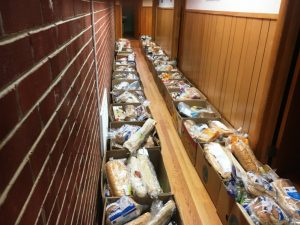 Food boxes lined the hallway at Snow Hill Baptist Church Sunday to be distributed during a drive thru pickup