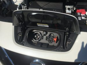 Photo shows electric charging ports in a Nissan Leaf which was brought to Smithville for a demonstration Monday