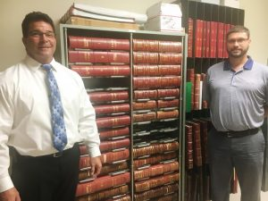 More than 138 years of county commission meeting minutes are currently stored in the archives of the clerk's office and up until now they have remained in their original paper forms, bound in books as shown here with County Clerk James L. (Jimmy) Poss (left) and Aaron Greer (right) of Business Information System, a company that offers software solutions to local governments. Images of these minutes have all been scanned, saved and are currently being uploaded to a web-based server where they will soon become available online for public viewing and printing, possibly by the end of next week.
