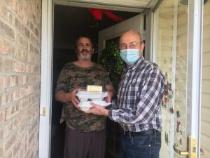 County Mayor Tim Stribling (right) delivers Thanksgiving Day meals to Jackie Fults on behalf of the DeKalb Emergency Services Association