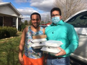 County Clerk James L. (Jimmy) Poss (right) delivers Thanksgiving Day meals to Jordan Pinegar on behalf of the DeKalb Emergency Services Association