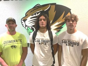 DCHS Tiger Coach Steve Trapp (left) earns Region 3,Class 4A Coach of Year Honor. Tiger Quarterback Axel Aldino (center) named Region Football MVP, and Tiger Wide Receiver Desmond Nokes (right) selected Region Offensive MVP