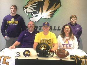 Evan Jones, a senior who played tight end and defensive end for the Tigers, signed a letter of intent in December to play for the Tennessee Tech Golden Eagles next year. Jones will graduate from DCHS in May. Evan was joined at the signing by his parents, Chris and Teresa Jones and his brothers and Ean (far left) and Eli (far right)