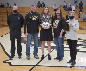 DCHS Lady Tiger Kadee Ferrell receives 1,000 Point Club game ball and award named in honor of Roy and Kathy Pugh
