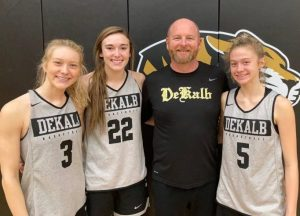 Kadee Ferrell (second from left) of the DCHS Lady Tiger basketball team made the 1st Team All-District and the All-District Defensive Team. Ella VanVranken (far right) was named the District's Freshman of the Year and she made the 3rd Team All-District. Megan Cantrell (far left) and Watertown's Brittni Allison shared the honor of being the District's Most Improved Players of the Year. Cantrell, Ferrell, and VanVranken are pictured here with Lady Tiger Coach Danny Fish