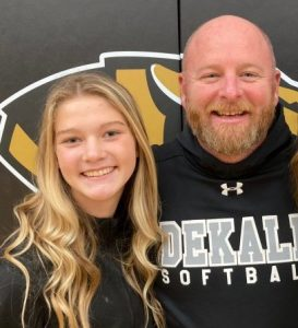 Cadee Griffith of the DCHS Lady Tiger basketball team was named to the District's All-Freshman Team . She is pictured here with Lady Tiger Coach Danny Fish