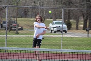 Both the Boys and Girls DCHS tennis teams won their matches against White County at home on Tuesday afternoon. The boys won their match 7 – 2 while the girls won 6 – 3. Tennis matches consist of six singles matches and three doubles matches. Ian Paladino shown here won 8-0