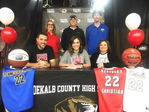 DCHS Junior Lady Tiger Basketball talent Kennedy Agee signed a letter of intent on Friday at DCHS to play for the Kentucky Christian University Lady Knights starting with the 2022-23 season after she finishes her high school career next year (2021-22). Pictured with Kennedy (center) are her parents Josh and January Agee. Standing left to right are KCU head coach Lisa Conn, and Kennedy's AAU Coaches Mike Johnson and Matt Ferrell, Program Director for Tennessee Rush based in Cookeville