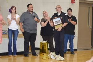 Band Director Tracy Luna receives plaque from band boosters.