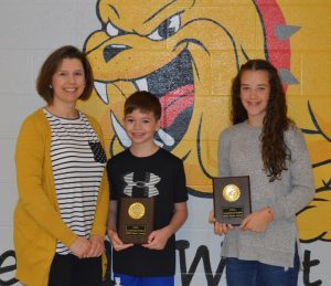 DeKalb West School students Hannah Brown and Kaden Mullinax each received plaques for earning 1,000 Accelerated Reader points this year. Kenadee Prichard (not pictured) also had that distinction. Shown here with DWS Librarian Amanda Mullinax