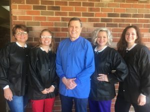 Longtime dentist Dr. Cliff Duke, who has been in practice since 1979, is retiring this month (tentatively June 25) completing 42 years of service to this community. Pictured here with his staff left to right: Gena Cripps, Shawnnie Davis, Dr. Duke, Danielle Reynolds, and Rachel Hendrixson