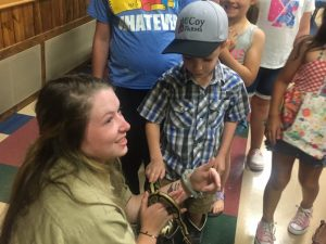 Mason Robinson, Seasonal Interpretive Park Ranger at Edgar Evins State Park brought in a live snake for the children to see last Thursday on final day of Library Summer Reading Program at the County Complex