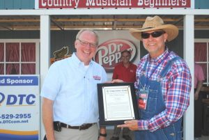 Sixth District Congressman John Rose praised the Fiddlers Jamboree for reaching this 50 year milestone and presented festival President and Coordinator Sam Stout a framed copy of his remarks on the floor of the US House of Representatives made part of the Congressional Record