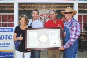 State Senator Mark Pody and State Representatives Terri Lynn Weaver and Clark Boyd presented Jamboree President and Coordinator Sam Stout a framed copy of a joint resolution adopted by the Tennessee State Senate and House of Representatives paying tribute to the Fiddlers' Jamboree.