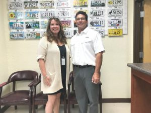 Katie Julian, county clerk liaison with the Tennessee Department of Revenue, recently stopped by to greet County Clerk James L. (Jimmy) Poss and the staff