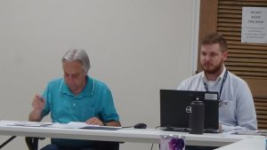 Dennis Stanley, Administrator of Elections and Chairman of the County Redistricting Committee with John Thomas, GIS specialist with the Tennessee Comptroller's office presenting a plan Tuesday night which the committee voted to recommend to the county commission for approval