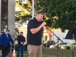 Chris Moore, minister of the Smithville Church of God led the gathering in a prayer for the country.