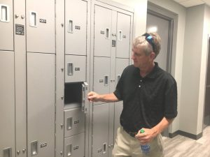 Wayne Oakley of Studio Oakley Architects, LLC of Lebanon who designed the new Smithville Police Department building pictured here at the evidence lockers during open house Sunday