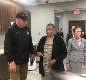 Smithville Police Chief Mark Collins welcomes Annette Evans during Open House of the new Smithville Police Department Building Sunday. Guylene Atnip pictured right