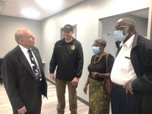 Smithville Police Chief Mark Collins welcomes Dr. Robert R. Atnip (left) and Jackie and Wade Smith during Open House of the new Smithville Police Department Building Sunday